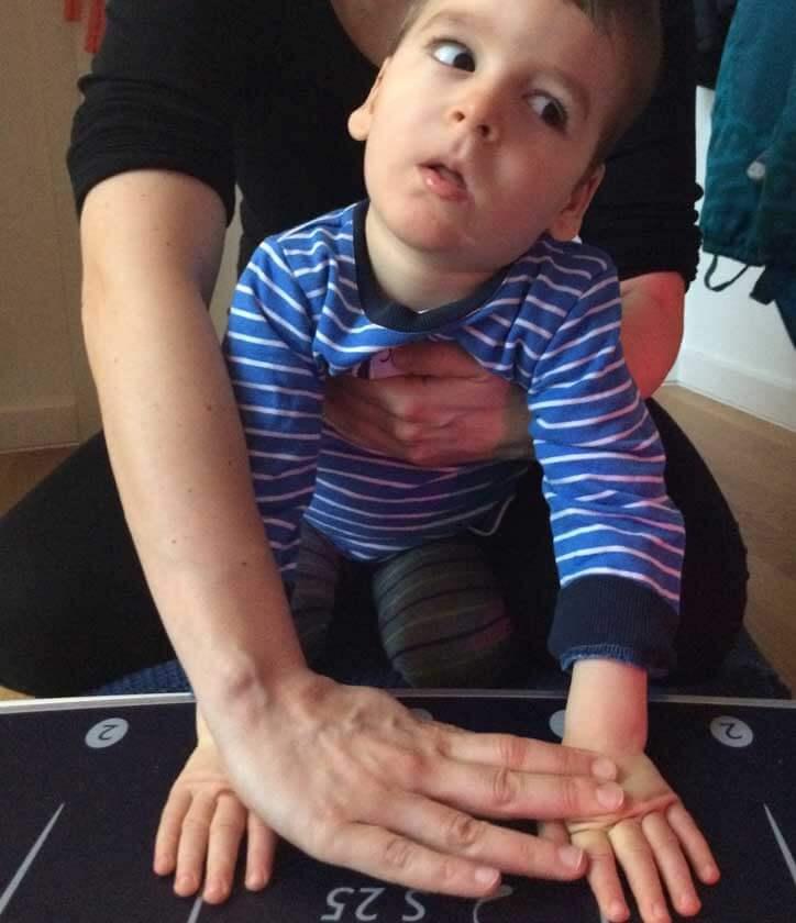 A little boy is sitting
