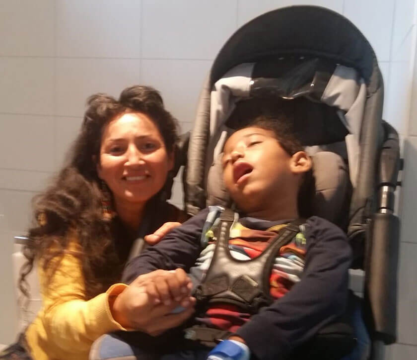 Child with mother in wheelchair