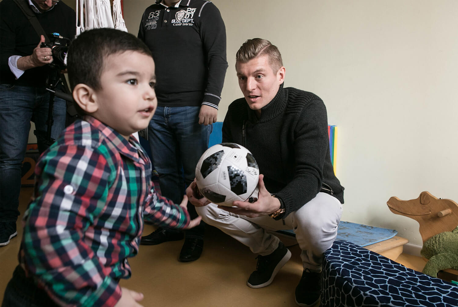 Toni Kroos with a little boy