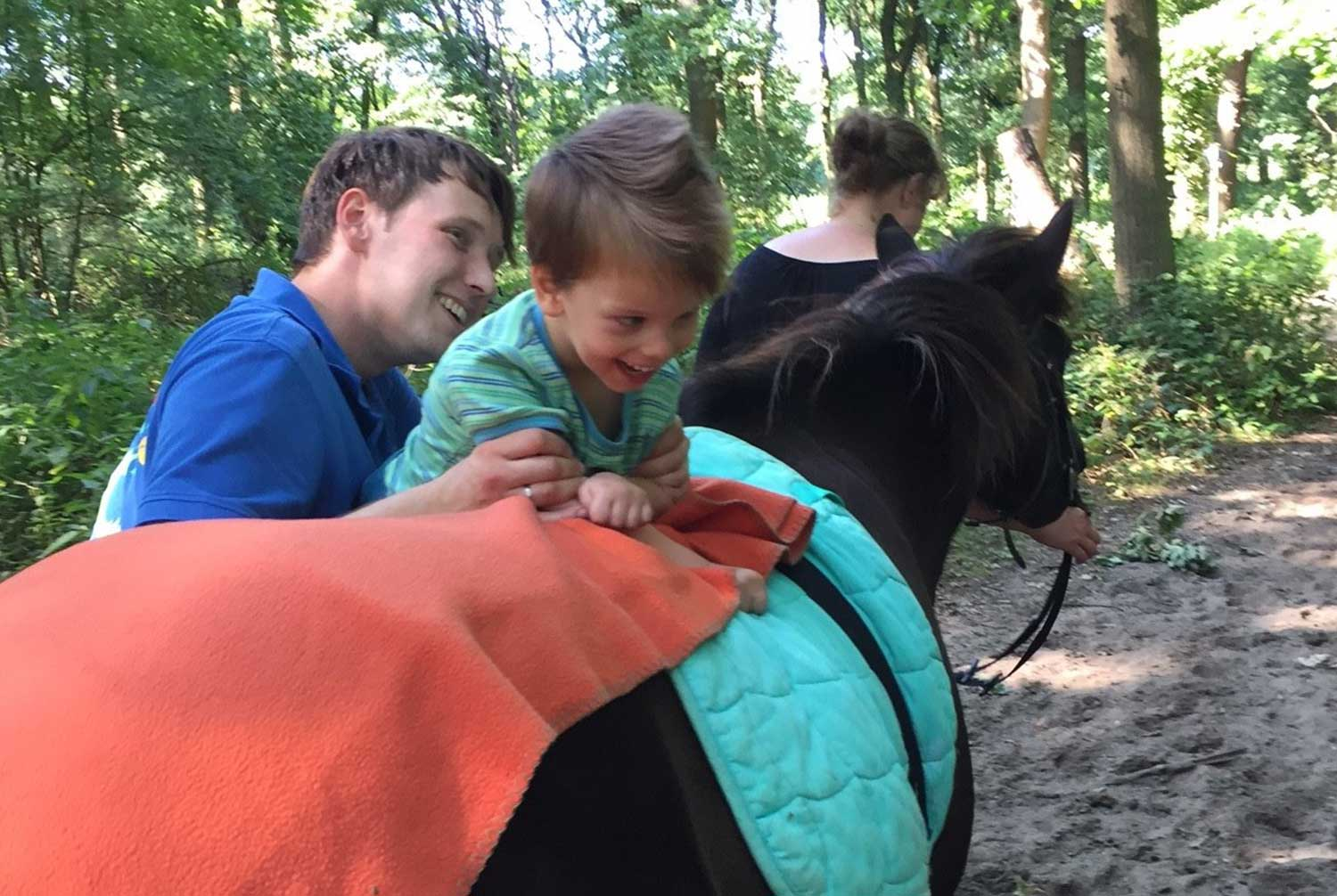 Little boy riding a horse